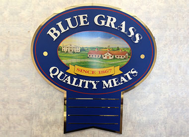 A new corporate identity was created. The blue ribbon of quality. Blue Grass Quality Meats.